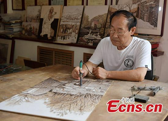 Man creates nearly 1,000 pyrography works in 20 years