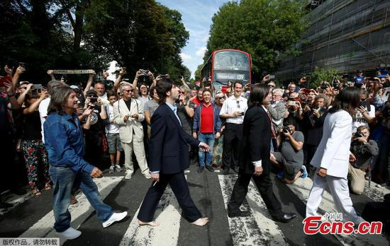 Beatles fans come together for 50th anniversary of Abbey Road photo