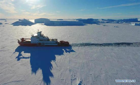 China's polar icebreaker Xuelong 2 breaks ice in waters in Antarctica